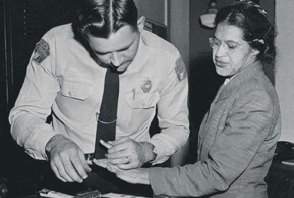 Photo: Rosa Parks being fingerprinted by Deputy Sheriff D. H. Lackey after being arrested for boycotting public transportation, Montgomery, Alabama, February 1956. Credit: Associated Press; Wikimedia Commons.