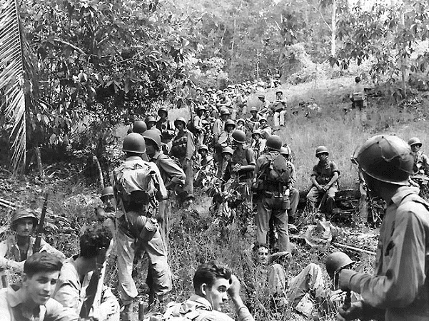Photo: U.S. Marines during the Guadalcanal Campaign, in the Pacific theatre, 1942. Credit: U.S. Navy; Wikimedia Commons.