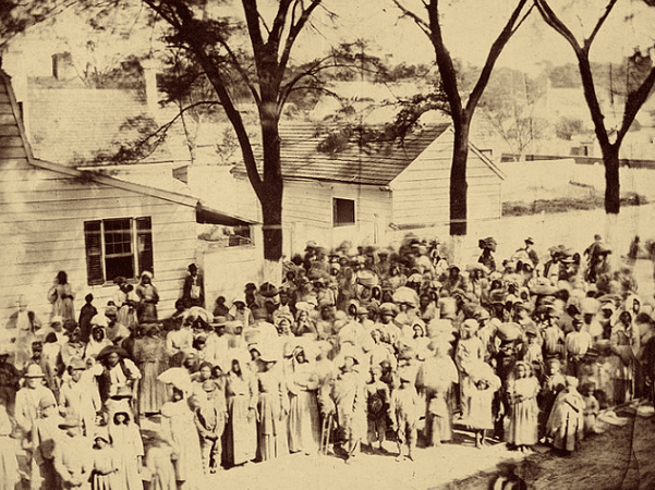 Photo: slaves on J. J. Smith's cotton plantation near Beaufort, South Carolina, photographed standing before their quarters in 1862. Credit: Timothy H. O'Sullivan; Getty Center; Wikimedia Commons.