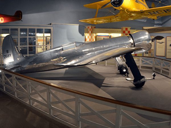 Photo: Howard Hughes's H-1 Racer airplane used to set his transcontinental speed record in 1937, on display at the National Air and Space Museum. Credit: D. Ramey Logan; Wikimedia Commons.