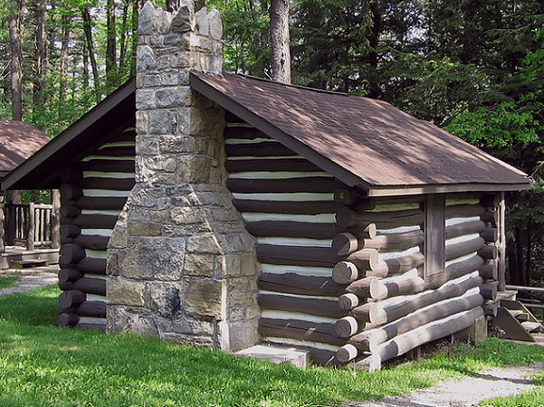 Photo: a log cabin built by the Civilian Conservation Corps between 1933 and 1937 in Black Moshannon State Park, Pennsylvania. Credit: Ruhrfisch; Wikimedia Commons.
