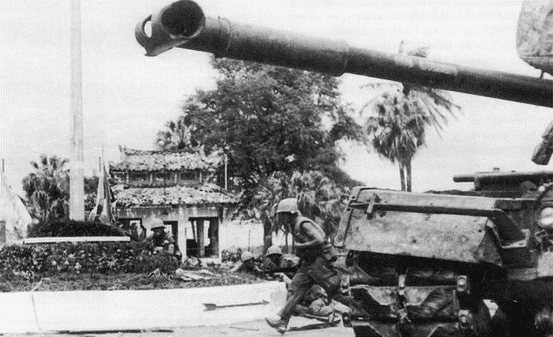 Photo: U.S. Marines advance past an M48 Patton tank during the battle for Huế during the Vietnam War's Tet Offensive