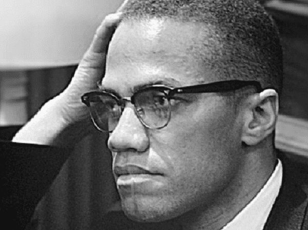 Photo: Malcolm X waiting for a press conference to begin on 26 March 1964. Credit: Marion S. Trikosko; Library of Congress, Prints and Photographs Division.