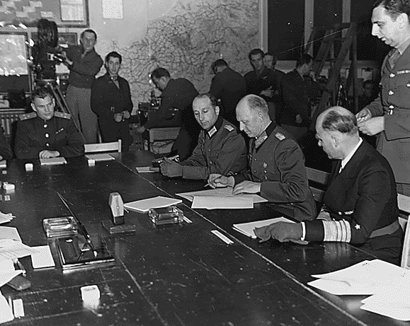 Photo: German General Alfred Jodl signs the instruments of unconditional surrender in Reims, France, on 7 May 1945