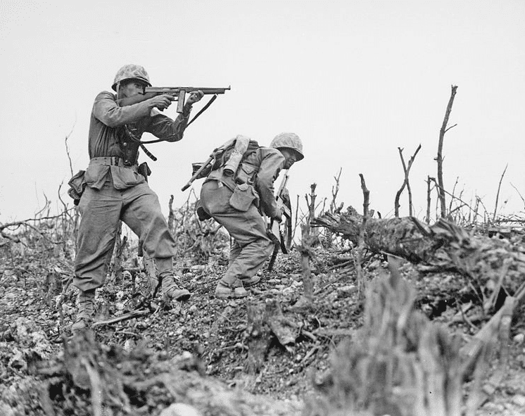 Photo: two Marines from the 2nd Battalion, 1st Marine Regiment during fighting at Wana Ridge during the Battle of Okinawa, May 1945