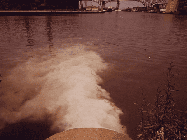 Photo: Cleveland pump station discharges sewage into Cuyahoga River, 1973. Credit: National Archives and Records Administration.