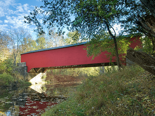 Photo: the Ramp Creek Covered Bridge at the north entrance of Brown County State Park, Indiana. Credit: Chuck Szmurlo; Wikimedia Commons.