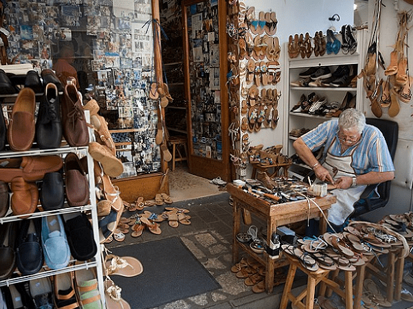 Photo: a cordwainer making shoes, Capri, Italy. Credit: Jorge Royan; Wikimedia Commons.