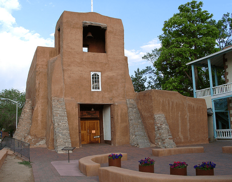 Photo: San Miguel Chapel, Santa Fe, New Mexico, the oldest church structure in the U.S. Original adobe walls built in approximately 1610 A.D.