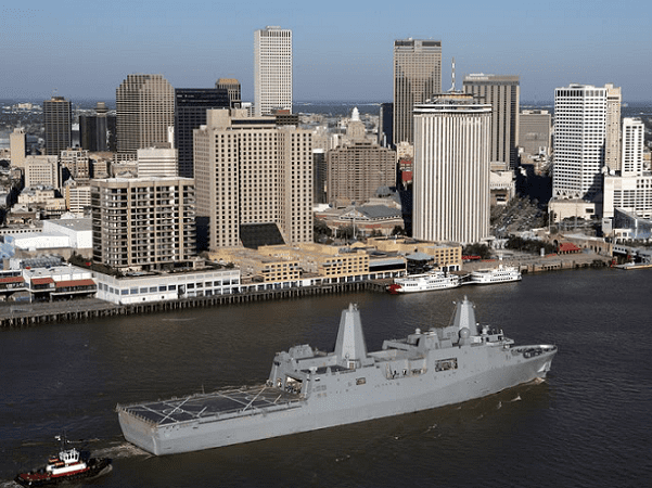 Photo: the USS New Orleans (LPD-18) passes by downtown New Orleans, Louisiana, on the Mississippi River. Credit: U.S. Navy; Wikimedia Commons.