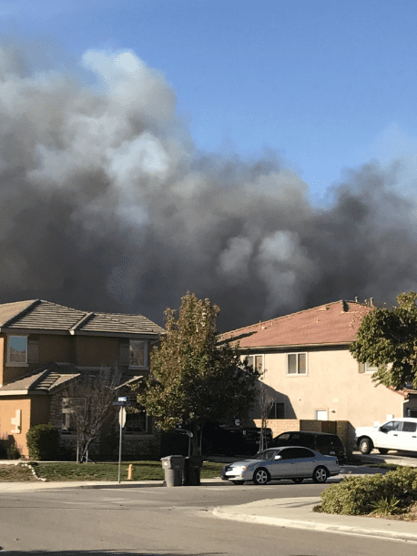 Photo: the author took this photo from her driveway as smoke and flames approached her neighborhood