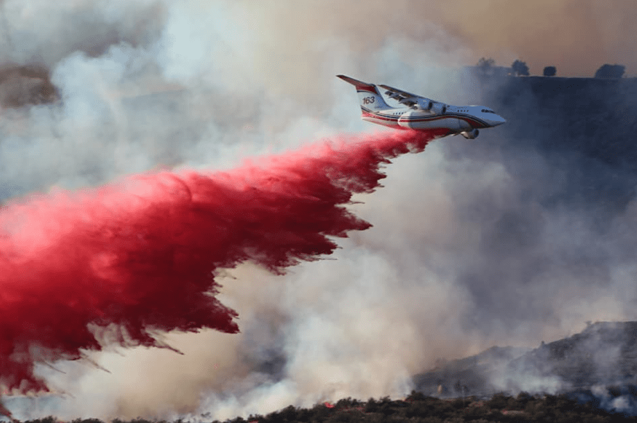 Photo: airplane dropping flame retardant