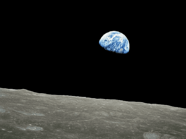 Photo: Earth rising above the moon's surface, taken by Apollo 8 astronaut William Anders on 24 December 1968. Credit: NASA; Wikimedia Commons.