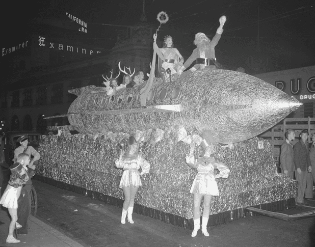 Photo: Christmas parade in Los Angeles, California, featuring a rocket ship float with Santa Claus, 1940