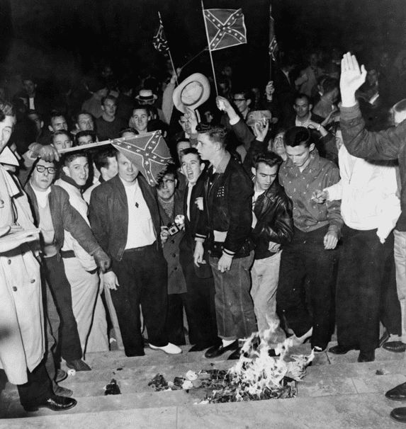 Photo: University of Alabama students burn desegregation literature during demonstration in Tuscaloosa, Alabama, 6 February 1956, against the enrollment of Autherine Lucy, an African American student