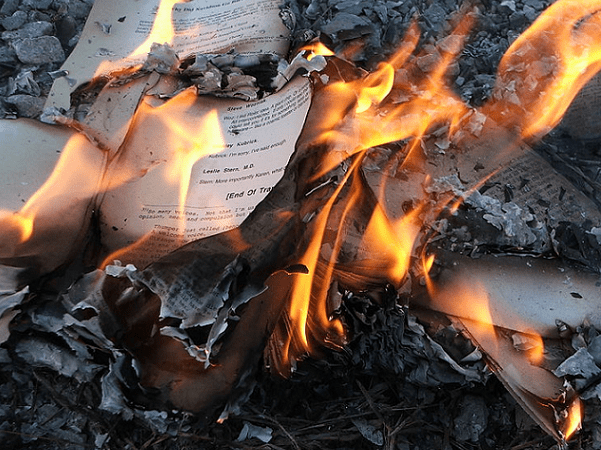 Photo: a burning book. Credit: LearningLark; Wikimedia Commons.