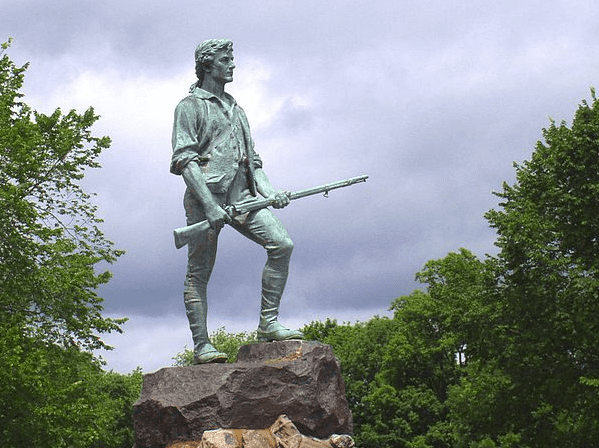 "Photo: ""The Lexington Minuteman,"" by Henry Hudson Kitson, erected in Lexington, Massachusetts, in 1900. Credit: Daderot; Wikimedia Commons."