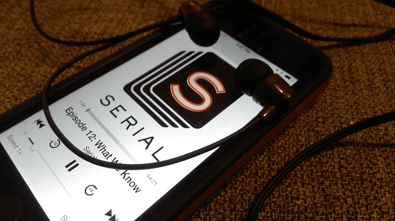 Photo: the Serial podcast being played on a smartphone, through headphones
