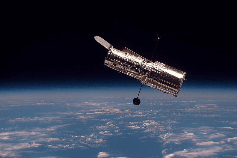Photo: the Hubble Space Telescope as seen from the space shuttle Discovery during its second servicing mission, 19 February 1997