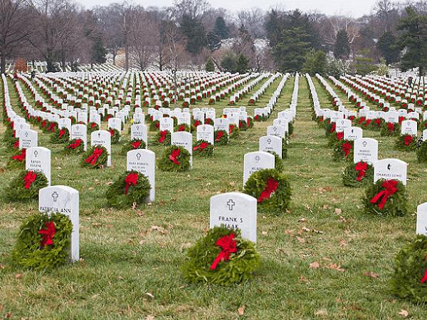 Photo: wreaths laid at Arlington National Cemetery. Credit: U.S. Army photo by Spc. James K. McCann; Wikimedia Commons.