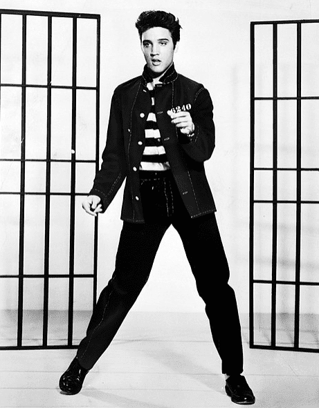 "Photo: a publicity photograph of Elvis Presley promoting the film ""Jailhouse Rock,"" 1957"