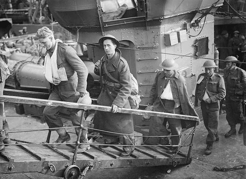 Photo: wounded British soldiers evacuated from Dunkirk make their way up the gangplank from a destroyer at Dover, England, 31 May 1940