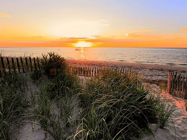 Photo: sunset on Cape Cod Bay in Brewster, Massachusetts. Credit: PapaDunes; Wikimedia Commons.