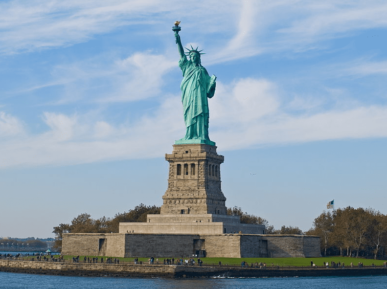 Photo: the Statue of Liberty (more formally, Liberty Enlightening the World, and more colloquially, Lady Liberty) is a structure located on Liberty Island in New York Harbor