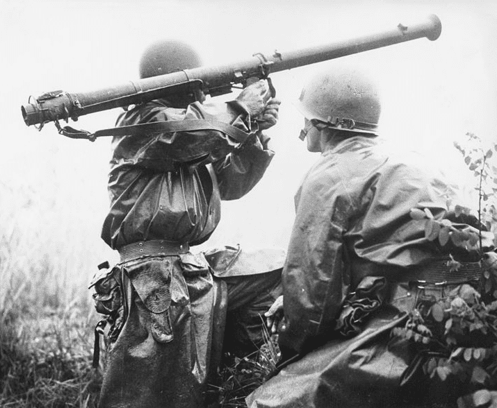 Photo: a team mans a bazooka at the Battle of Osan. Members of the 24th Infantry Division, first United States ground units to reach the front, go into action against North Korean forces at the village of Sojong-Ni, near Osan