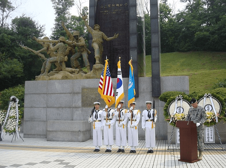 Photo: South Korean sailors in formation in front of the Task Force Smith memorial at Osan, South Korea