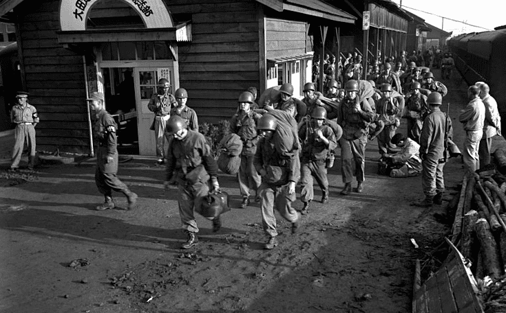 Photo: Task Force Smith arrives in South Korea: the first units of U.S. Army ground forces to arrive debark from trains in Taejŏn, South Korea, 1950