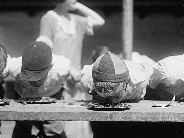 Photo: pie-eating contest at the Jefferson School, Washington, D.C., 2 August 1923. Credit: Library of Congress, Prints and Photographs Division.