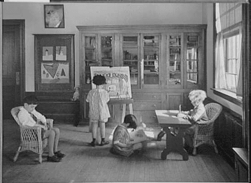 Photo: children painting, reading and writing, between 1930 and 1940