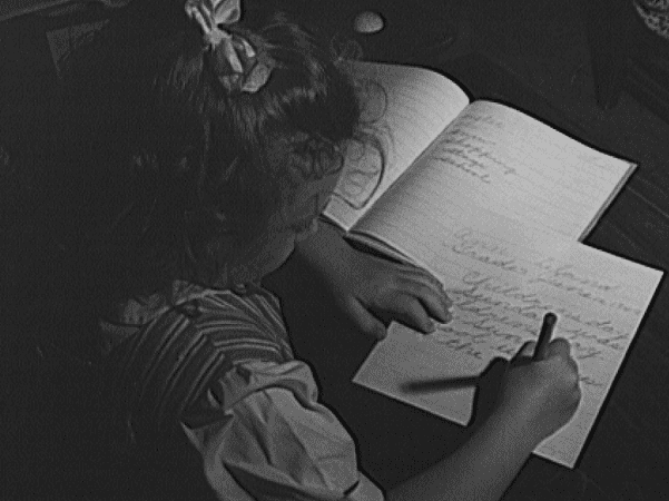 Photo: girl writing; the open notebook is her personal speller, 1943. Credit: Philip Bonn; Library of Congress, Prints and Photographs Division.