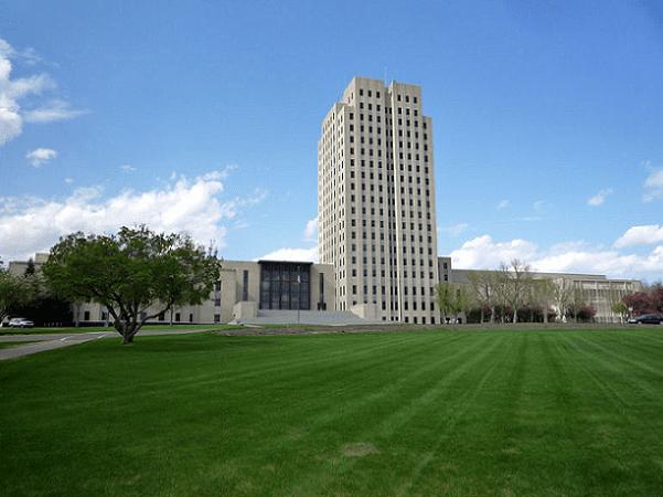 Photo: North Dakota State Capitol, Bismarck, North Dakota. Credit: Bobak Ha'Eri; Wikimedia Commons.