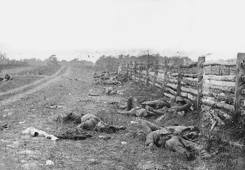 Photo: dead Confederate soldiers from Starke's Louisiana Brigade, on the Hagerstown Turnpike, north of the Dunker Church, Battle of Antietam