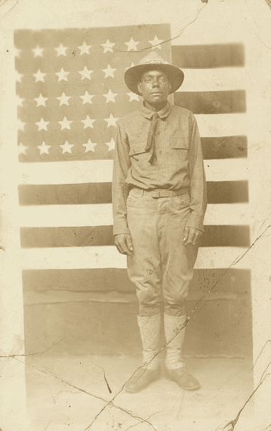 Photo: World War I soldier with American flag in background