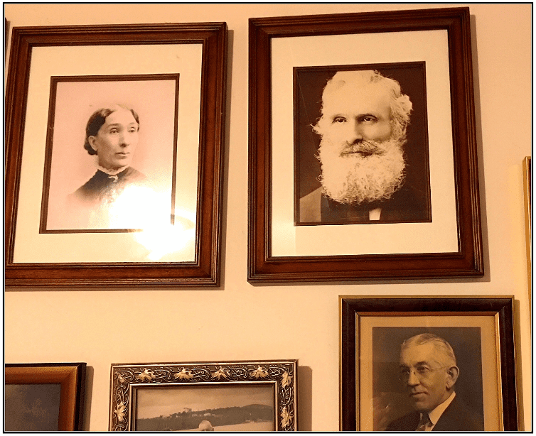 Photo: pictures of ancestors hanging on a wall