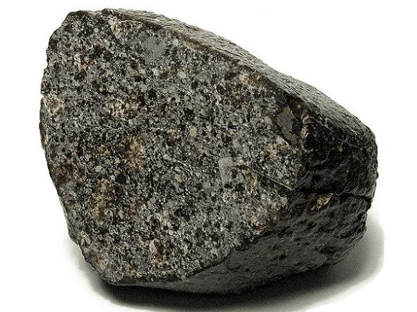 Photo: small meteorite from the NWA 869 strewn field, near Tindouf, Algeria. Credit: H. Raab; Wikimedia Commons.