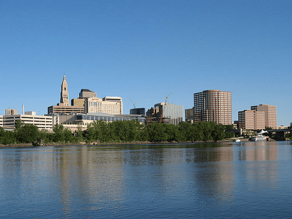 Photo: the skyline of Hartford, Connecticut, as seen from across the Connecticut River. Credit: Elipongo; Wikimedia Commons.