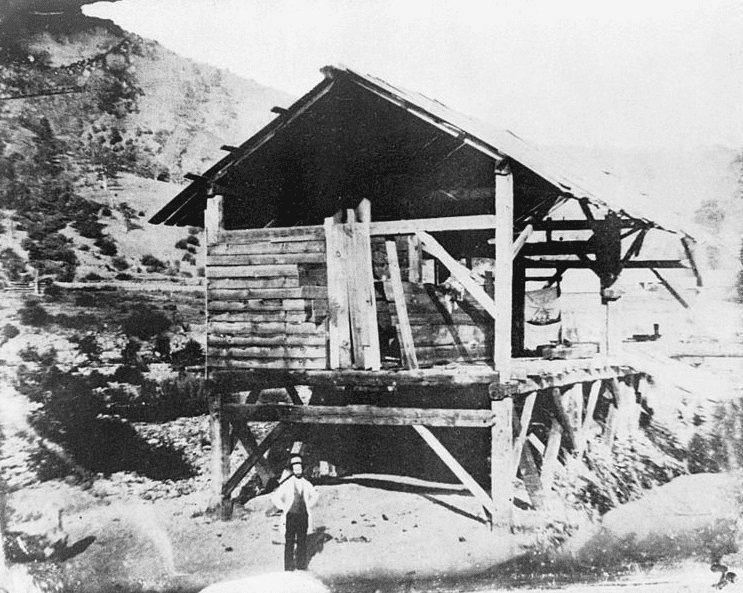 "Photo: ""Photomechanical reproduction of the 1850 daguerreotype by R. H. Vance shows James Marshall standing in front of Sutter's sawmill, Coloma, California, where he discovered gold."""