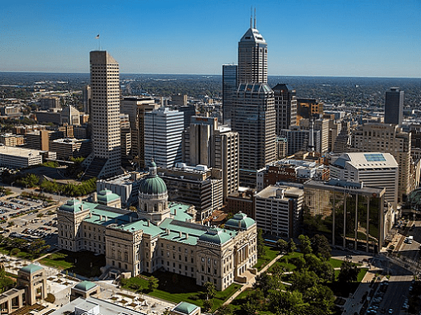 Photo: aerial view looking east northeast across downtown Indianapolis, Indiana, with the Indiana Statehouse in the foreground. Credit: tpsdave; Wikimedia Commons.