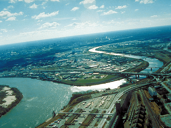 Photo: aerial view of Kansas City, Kansas, looking southwest. The Kansas River (right-center) joins the Missouri River (left). A small piece of Kansas City, Missouri, is visible on the left of the Missouri River. Credit: U.S. Army Corps of Engineers.