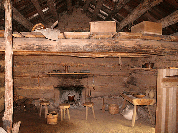 Photo: interior of a recreation of a log cabin at Conner Prairie living history museum in Fishers, Indiana