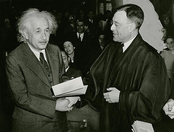 Photo: Albert Einstein receiving from Judge Phillip Forman his certificate of American citizenship, 1 October 1940