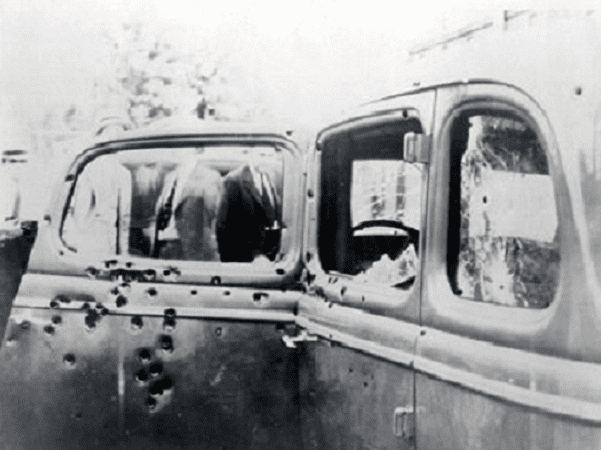Photo: Bonnie and Clyde's car (1932 Ford V-8), riddled with bullet holes after the ambush. Picture taken by FBI investigators on 23 May 1934. Credit: FBI; Wikimedia Commons.