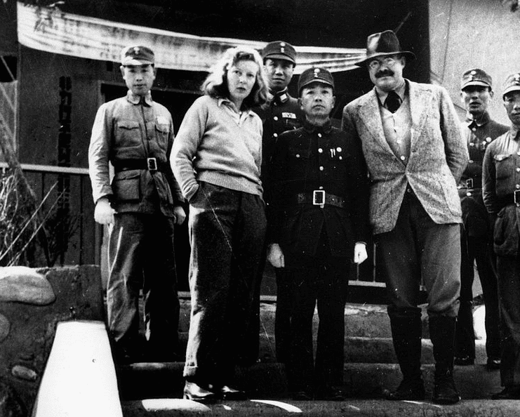 Photo: Martha Gellhorn and Ernest Hemingway with unidentified Chinese military officers, Chungking (Chongqing), China, 1941
