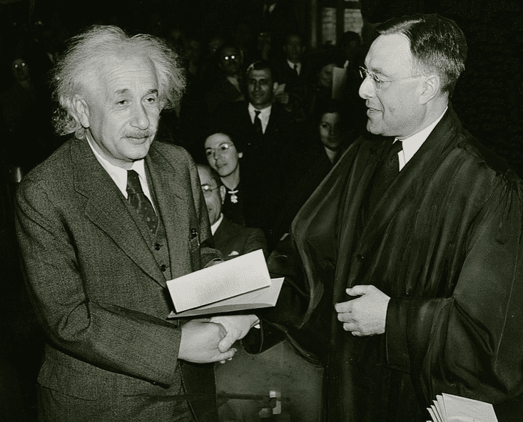 Photo: Albert Einstein receiving his certificate of American citizenship from Judge Phillip Forman, 1 October 1940