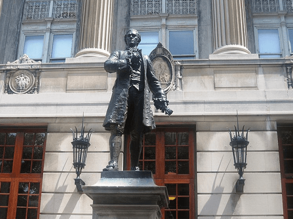 Photo: a statue of Alexander Hamilton, by William Ordway Patridge, standing outside of Columbia University's Hamilton Hall, New York City. Credit: Billy Hathorn; Wikimedia Commons.