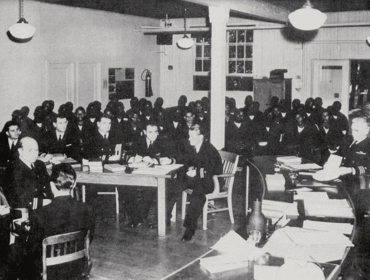 Photo: the Navy defense team sits in front of the 50 accused sailors during the trial on Treasure Island in 1944